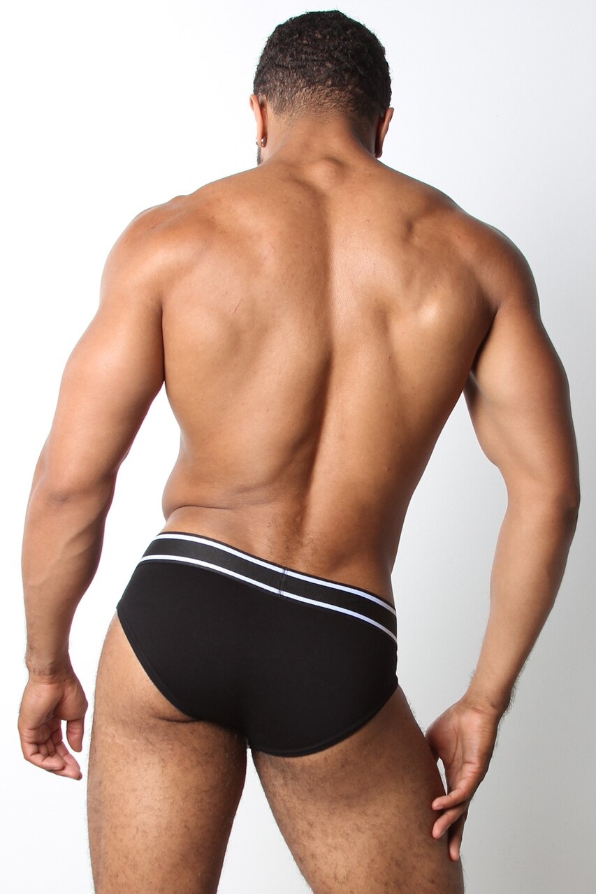 A male model wearing CB13 Relay Brief White-Black (back)